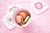 Colorful macaroons in a paper cup