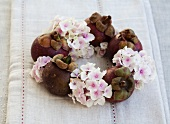 Wreath made of hydrangeas and mangosteens