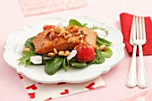 Roasted salmon fillets with shallots, cherry tomatoes, hazelnuts and petals