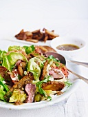 Bread salad with lamb, olives and tomatoes