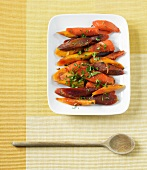 Cooked Organic Rainbow Carrots with Parsley on a Serving Platter; From Above