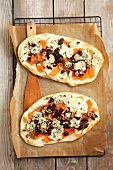 Tarte flambée with pumpkin, Gorgonzola, cranberries and hazelnuts