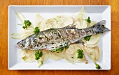 Baked bass with parsley and lemon on a bed of fennel