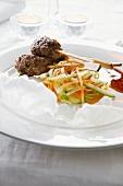 Beef skewers with steamed vegetables