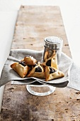 Haman parcels (Jewish pastries filled with plum purée) and a sugar caster