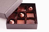 A Box of Assorted Chocolates on a White Background