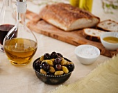 Bowl of Mixed Olives; Olive Oil and Bread in Background