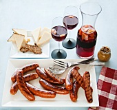 Platter of Grilled Sausages, Cheese Plate and Glasses and Pitcher of Sangria