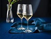 Two Glasses of White Wine on Blue