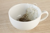 A Used Tea Bag in an Empty White Tea Cup