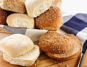 Assorted rolls, some sliced in half, some in a bread basket