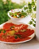 Tuna carpaccio with pesto and coriander leaves