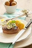 Fillet steak with quark and herb butter and boiled potatoes