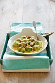 Brussels sprouts with slivered almonds and cheese sauce
