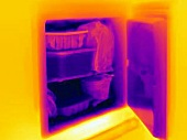 An infra-red image of an open refrigerator