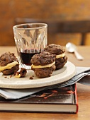 Small chocolate and mocha whoopie pies with a cup of coffee
