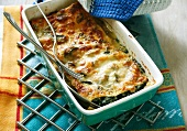 Spinach lasagne in the baking dish