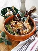 Rabbit with olives and pine nuts