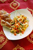 Indian scrambled egg with tomatoes, spring onions and flatbread
