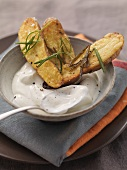 Baked potatoes with rosemary and sour cream dip