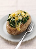 Twice-baked potato with cheese and spinach