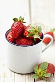 Strawberries in an enamel cup