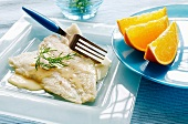 Plaice fillets with orange and cream sauce