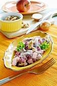 Potato salad with young herring, beetroot and walnuts (The Netherlands)