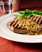 Grilled steak with green pepper sauce