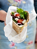 Pita filled with Greek salad