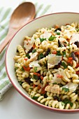 Pasta salad with shavings of parmesan