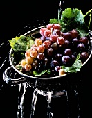 Grapes being washed in a sieve