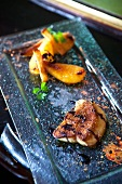 Fried duck liver with elderberry sauce, pears and honey