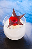 Coconut meringue with pears, red fruits and chocolate leaves