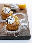 Lemon cupcakes with meringue and icing sugar