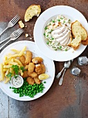 Breaded scampi with chips and peas, and ribbon pasta with chicken and peas