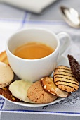 A cup of espresso with assorted biscuits