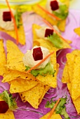 Tortilla chips with houmous and beetroot cubes