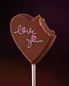 A chocolate heart with a bite missing