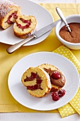 Sponge roll with chocolate mousse and raspberries