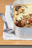 Moussaka in a casserole dish (section)