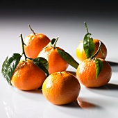 Mandarins with stems and leaves