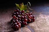 Red grapes with a vine leaf