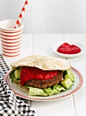 Lamb burger with beetroot sauce in pita bread