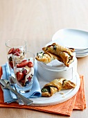 Muesli with berries and yoghurt, served with spinach and ham croissants