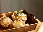 Potatoes baked in paper with a herb dip