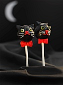 Cake pops decorated to look like black cats