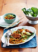 Chinese-style marinated chicken fillet with Hokkien noodles and pak choi