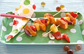 Skewers of fish fingers, pineapple and peppers