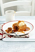 A mini date and pecan tart with caramel sauce